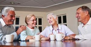 Seniors having coffee